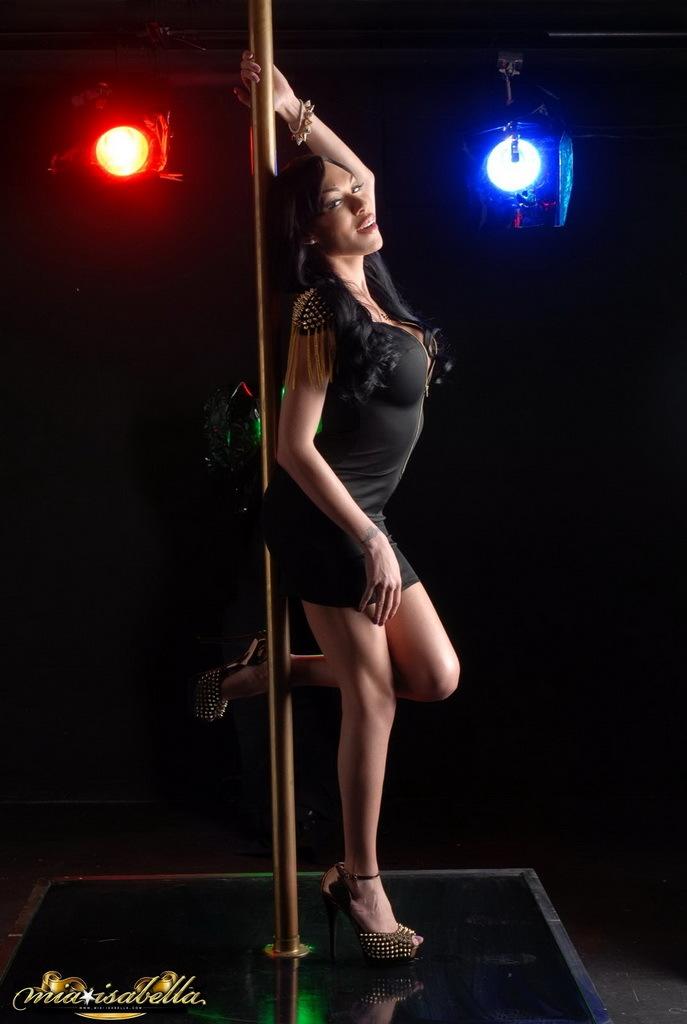 attractive mia strips and pole dances