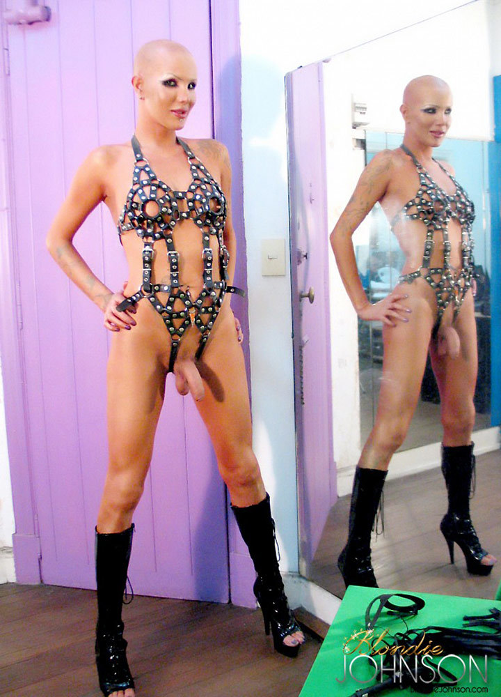 bald ladyboy in leather straps and mask