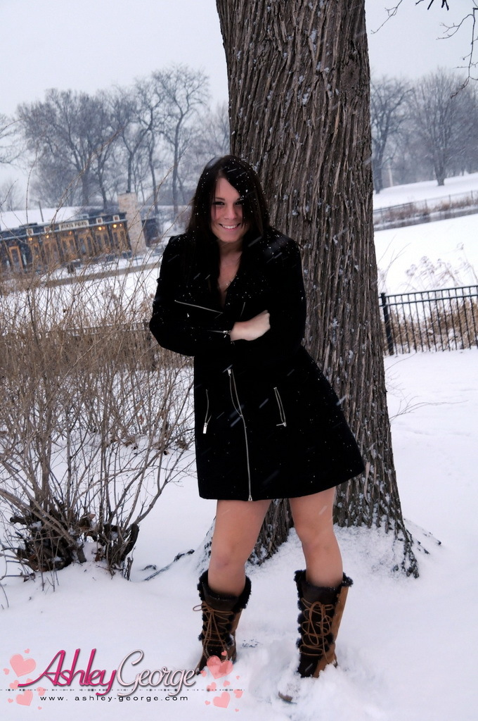 horny shemale ashley george posing outdoors in the snow