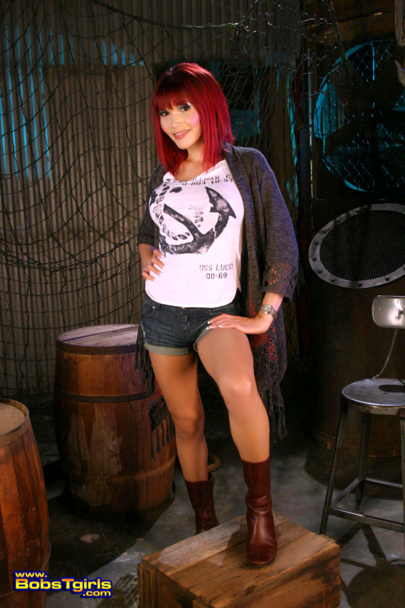 titillating redhead eva lin posing as a sailor girl