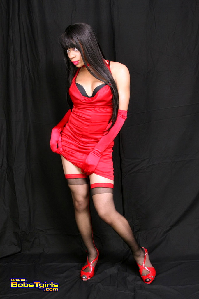 ts sasha posing in spicy red skirt black stockings